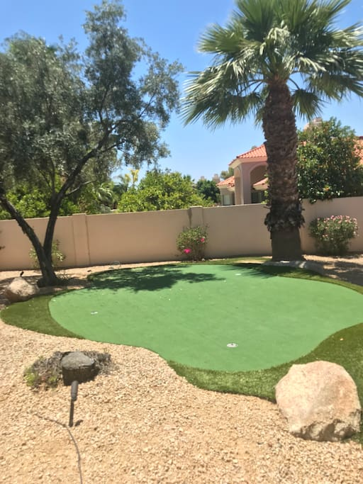 Putting green on side of house
