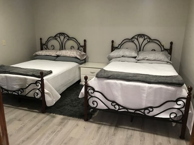 """2 Full size beds.  One with a pillow top mattress and the other a 6"""" memory foam topper."""
