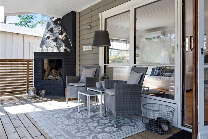 A big veranda with a lovely fireplace to use on chilly evenings