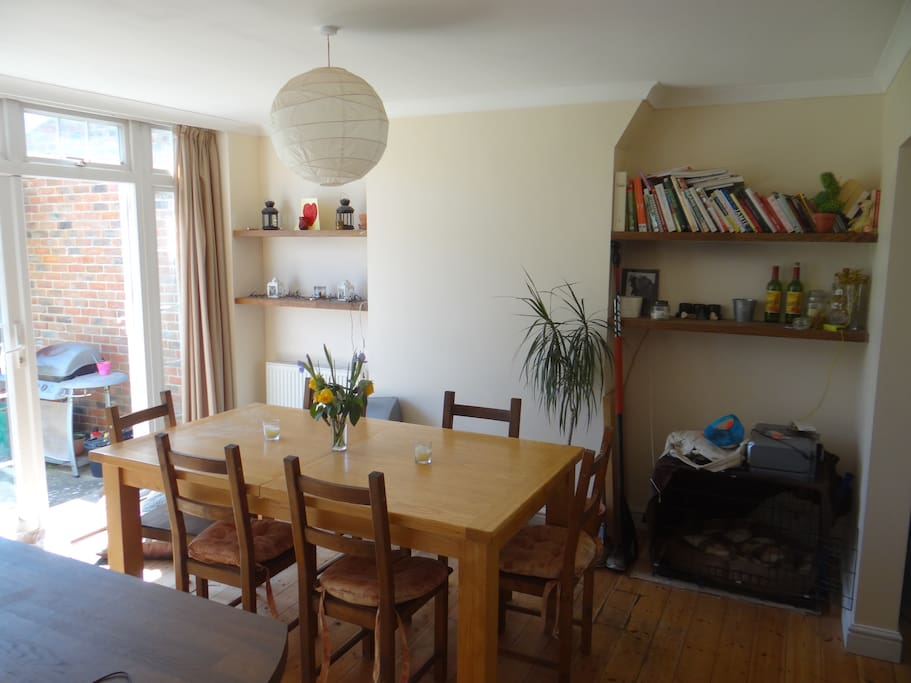 Large oak dining table which can extend to seat 8 comfortably (not extended in this picture)