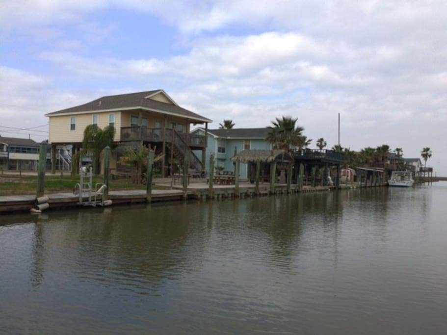 Yellow canal home, with access to bays and gulf.