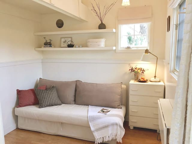 Studio with loft above. Sofa folds out easily for additional bed (firm, size is a few inches smaller than a standard queen).