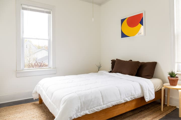 Bright and simple master bedroom with a Casper Mattress