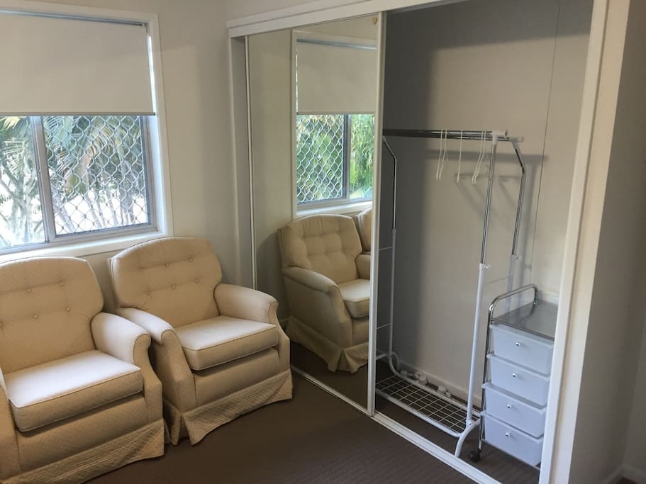 Armchairs and built-in wardrobe in the room