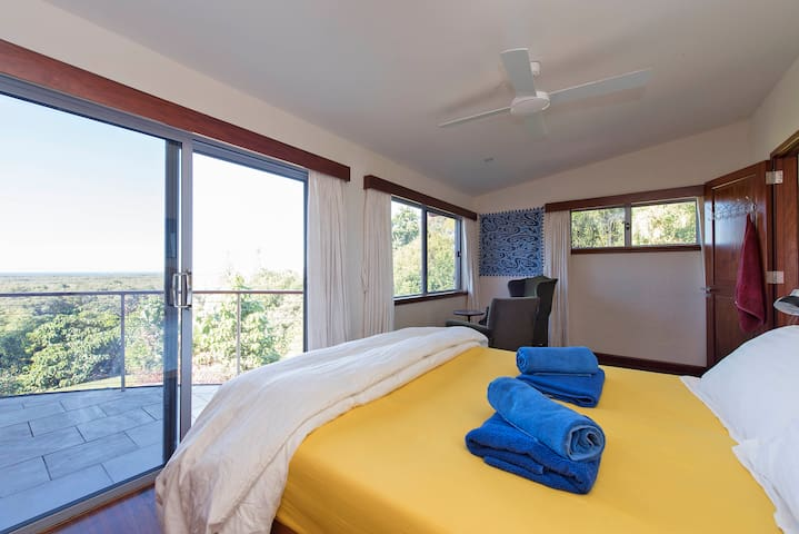 Your bedroom with views across Byron Bay to the light house