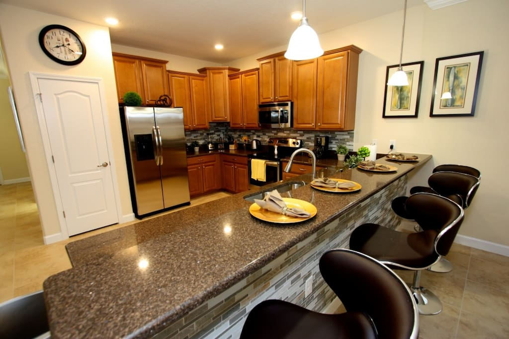 Large kitchen with granite countertops and stainless steel appliances