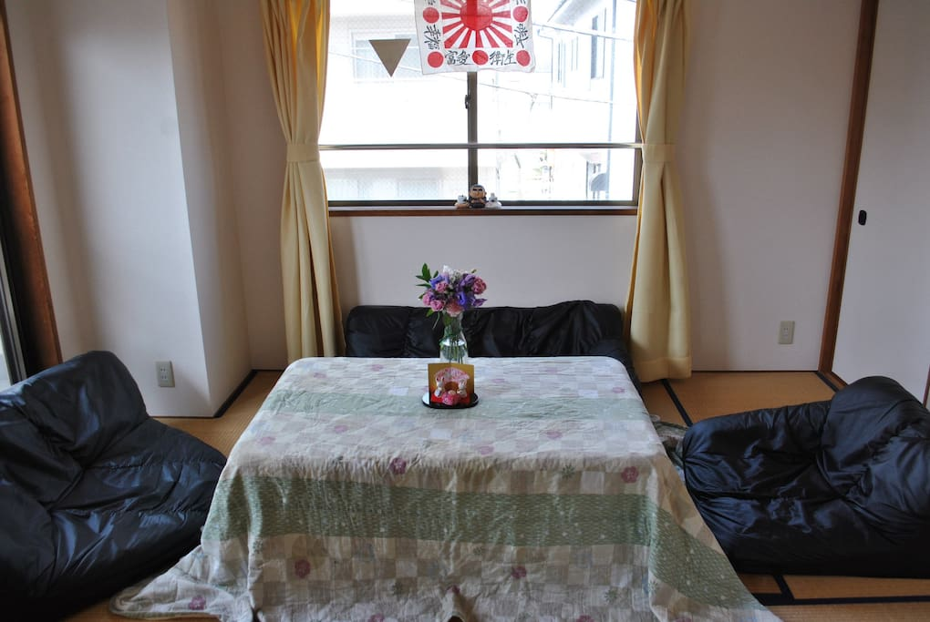 "Here is our ""washitsu"" or Japanese-style room . It can comfortably accommodate three people. On a clear day, you can see Mt. Fuji from here!"