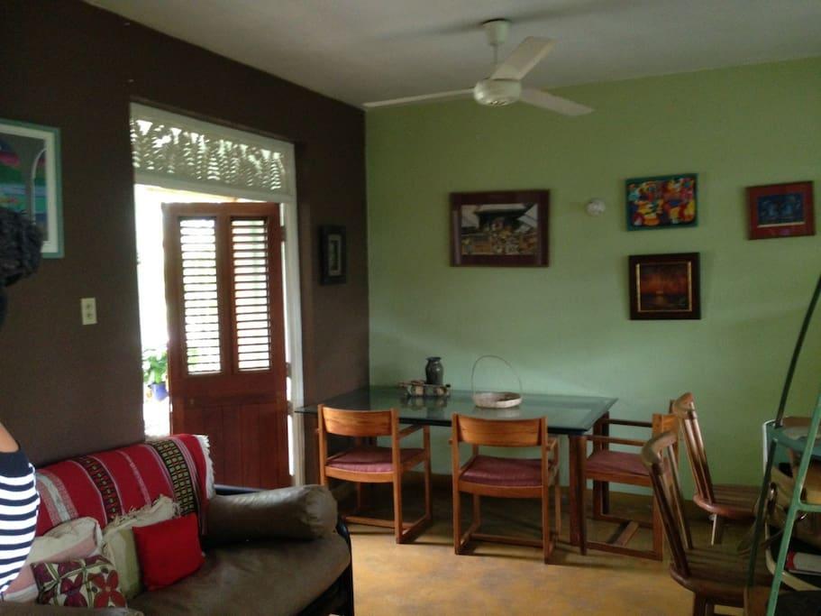 living and dining area open on to an enclosed patio