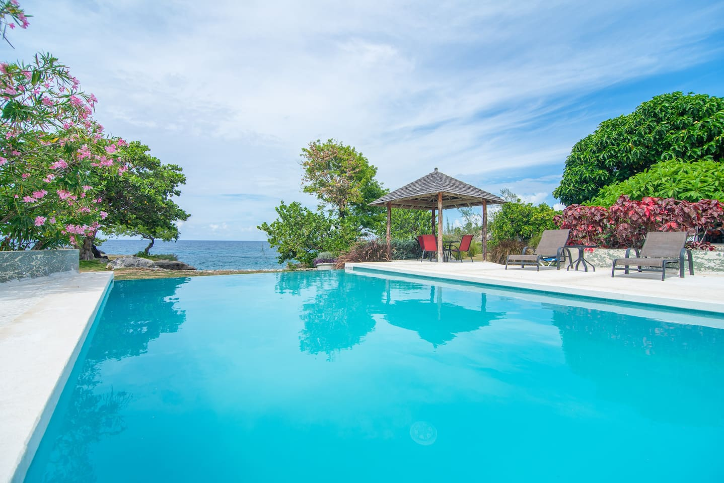 Newly renovated pool, larger and more lovely ocean view