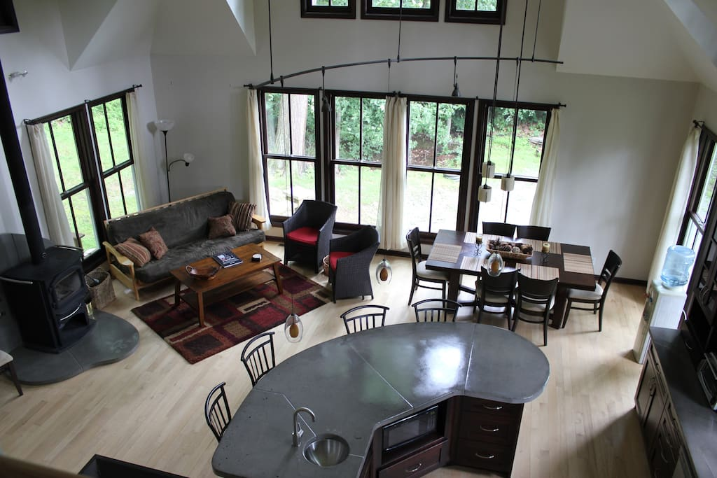 The greatest room, located within the kitchen and dining room. This sitting room is equipped with a wood stove, wall to wall windows and doors for a panoramic view of the great outdoors. the true cathedral ceiling increases the expansiveness of this space, leaving you feeling like you are in a looking glass.