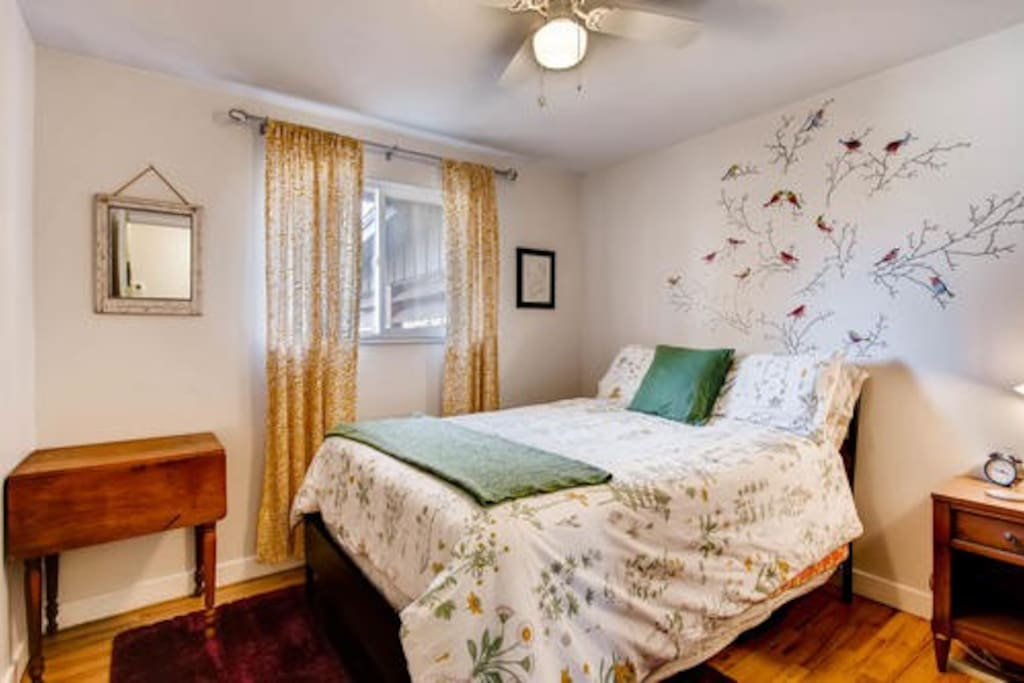 The room includes vintage furniture and peaceful decor.