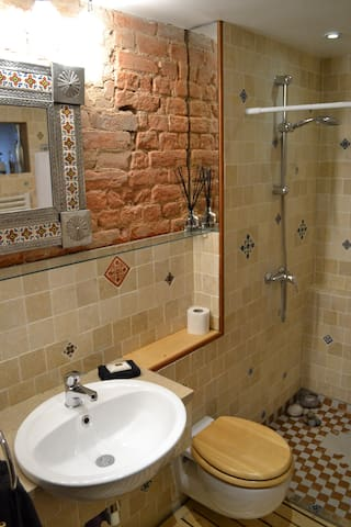 Hand-crafted natural stone bathroom