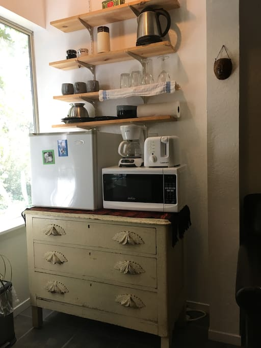 Kitchen includes mini-fridge, microwave, toaster, coffee maker, and electric kettle, dishes and essential utensils.
