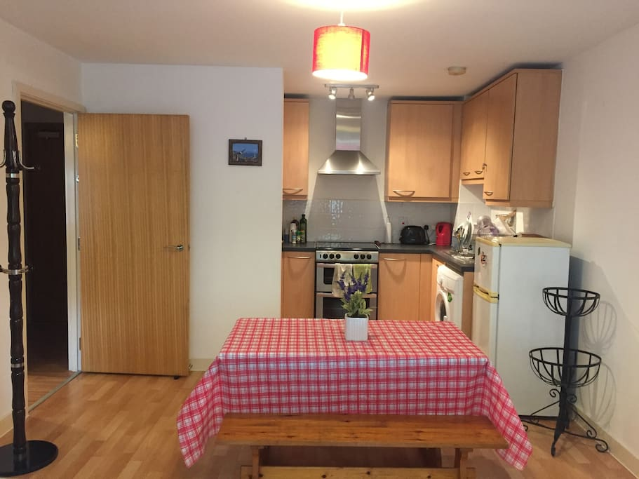 Dining room and kitchen, with washing machine available also.