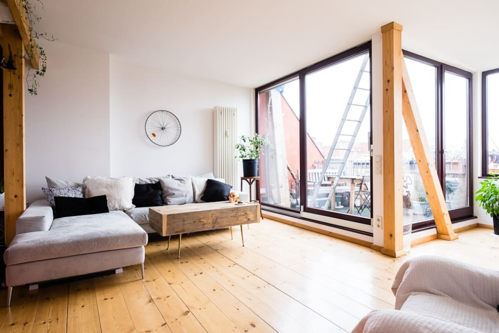 Main room, with huge floor-to-ceiling sliding windows ushering you into the rooftop patio. Electric blinds provide immediate privacy at the push of a button.