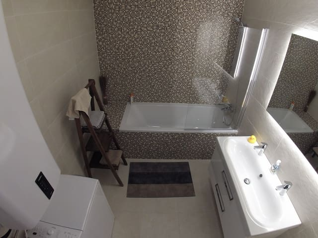 Luxury bathroom with separate WC. Washing machine and own hot water heating