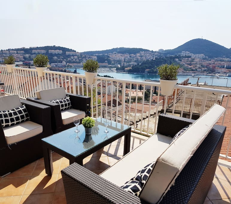 The spacious, sun bathed terrace offers guests a place to enjoy the sea view and relax