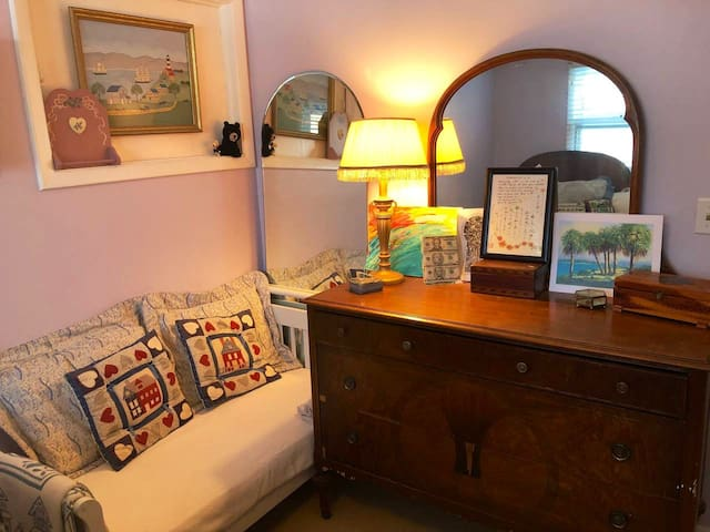The dresser drawers are all yours, and the little loveseat is a great place to organize all the things for tomorrow, or leave an open suitcase if that's more comfy for you!