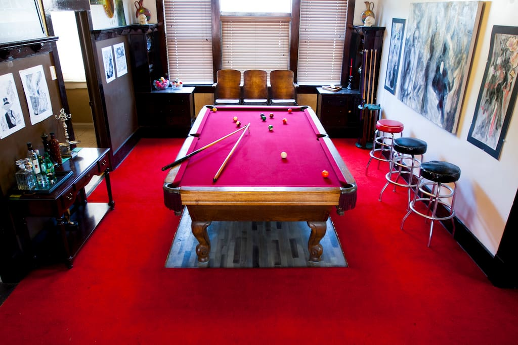 Pool room Covered in fine art and entertainment amenities.