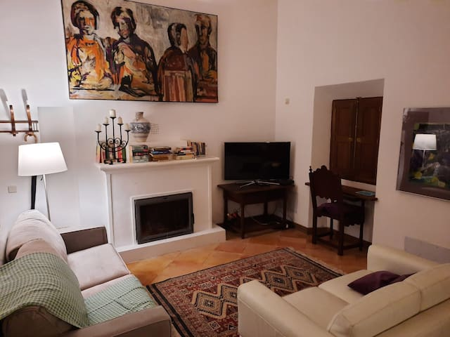 Living Room; Two Sofas, Desk Area with views to Soller Town and Fireplace.
