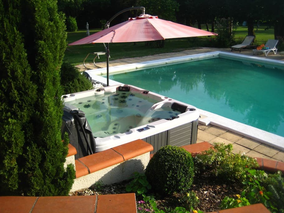 Very large pool and hot tub, heat exchanger can be turned on by arrangement.