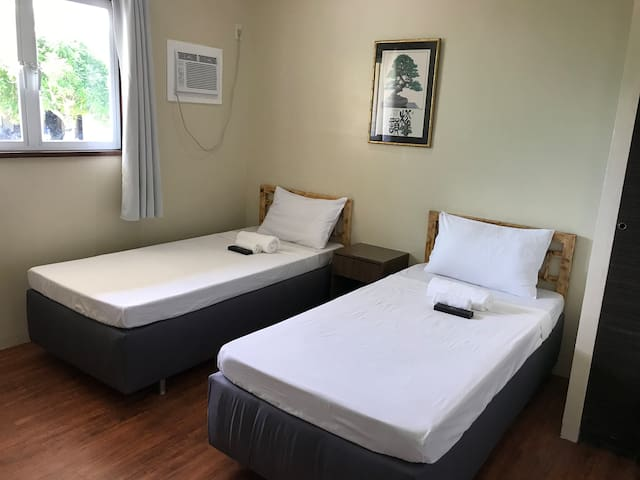 Bedroom #5 has two single beds for 2 occupants. The beds can be joined side by side to form a king-size bed for a couple. It has an ensuite bathroom with hot/cold shower.