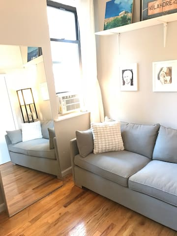Living room  with full length mirror