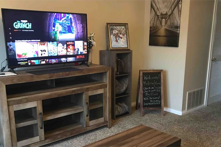 Holiday Decorated! Living room 60 inch tv, with Netflix & WiFi included. Watch your favorite YouTube videos or connect your smart devices to the internet!