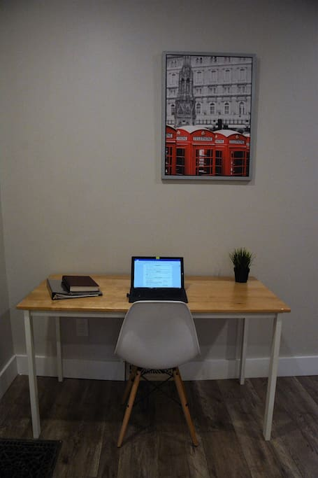 Handmade birch desk and a comfy chair for any work you might bring with you.