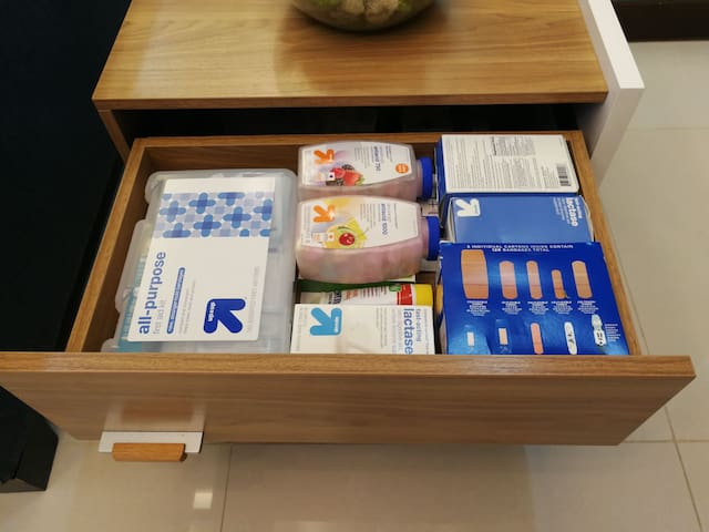 First Aid Kit: Various size Band-Aids, Gauze, Wound antibiotic ointment, Itch cream (diphenhydramine cream and Hydrocortisone cream), Antacids, Burn ointment, and Lactaid (for lactose intolerance).
