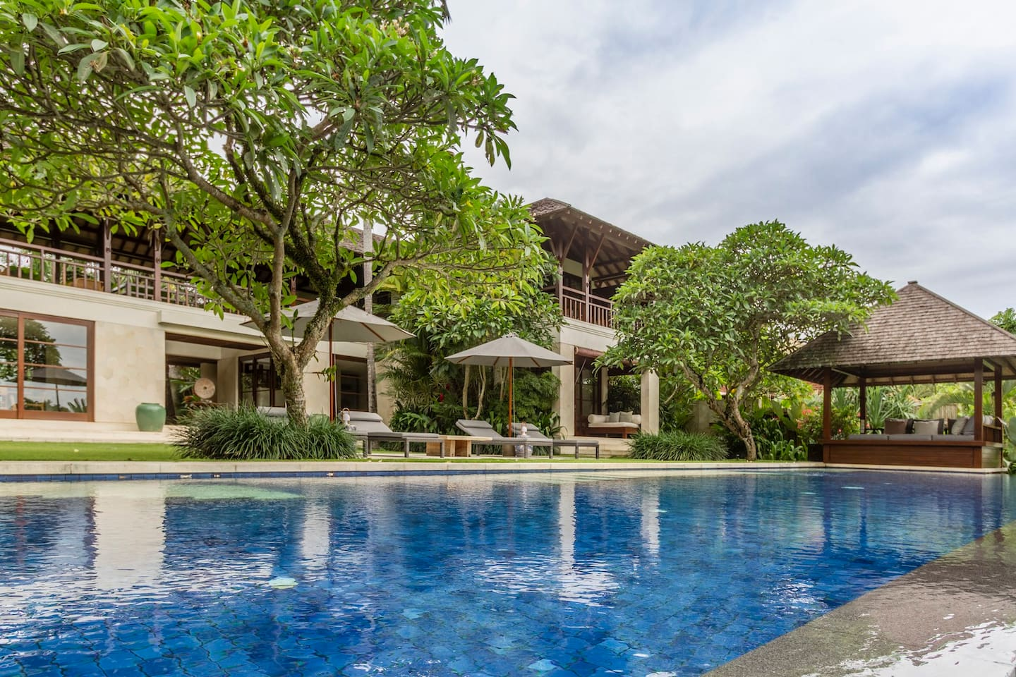 This private retreat offers spectacular views over cascading rice-terraces and a small jungle-clad river valley in a peaceful, traditional Balinese village within the sought-after Canggu area.