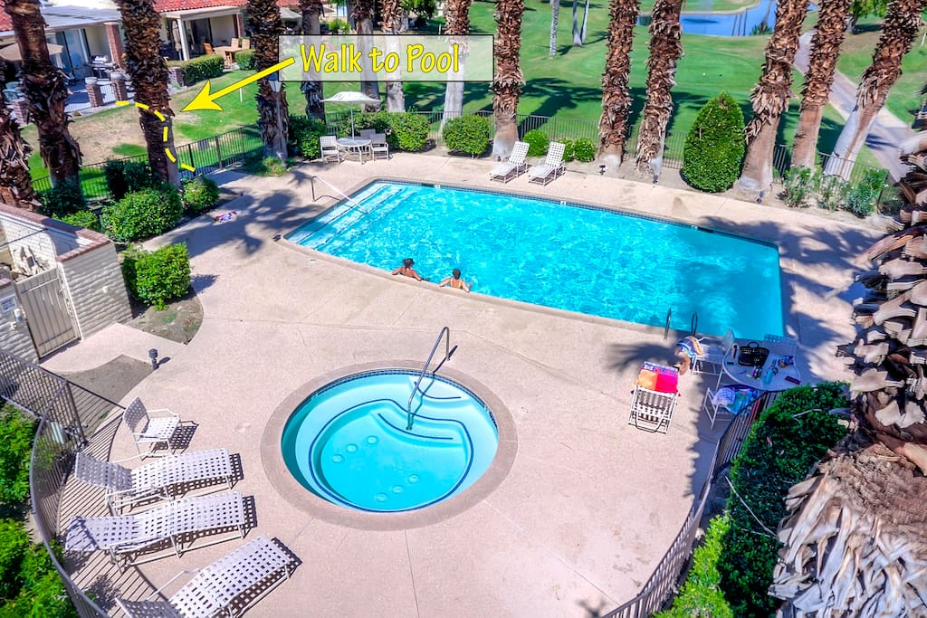 Aerial photo of South facing back patio with extended gated deck. Resort beach towels furnished