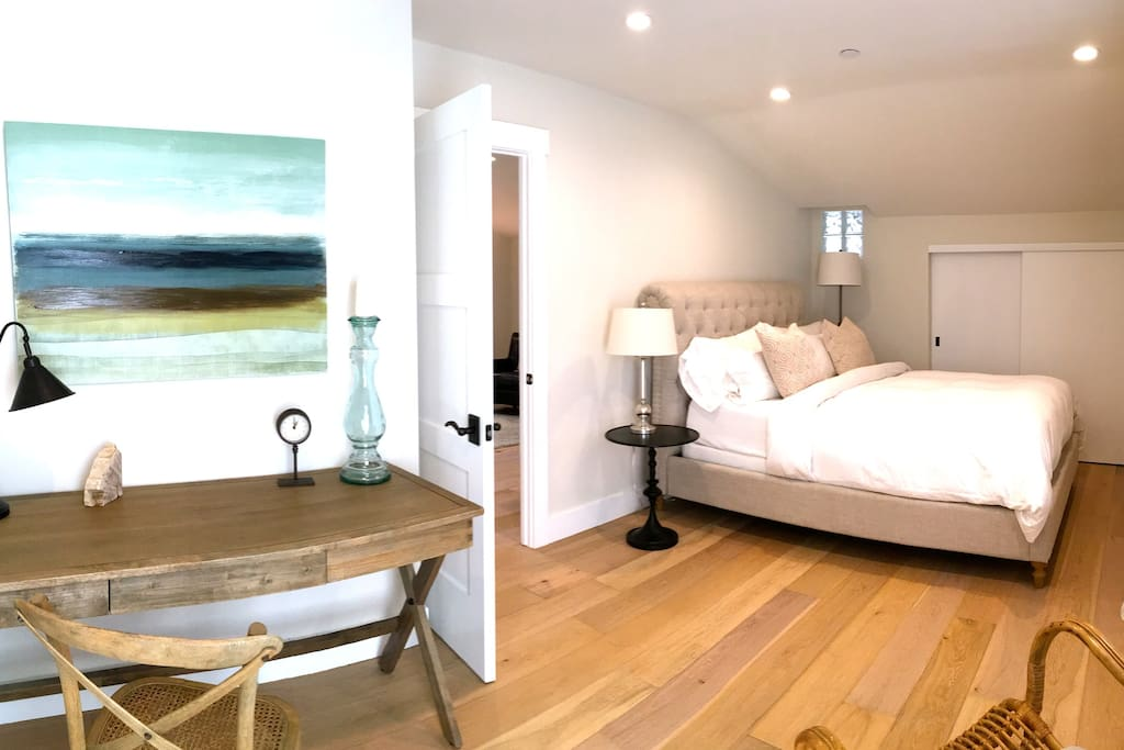 Large and beautiful bedroom with Restoration Hardware bed and luxury mattress