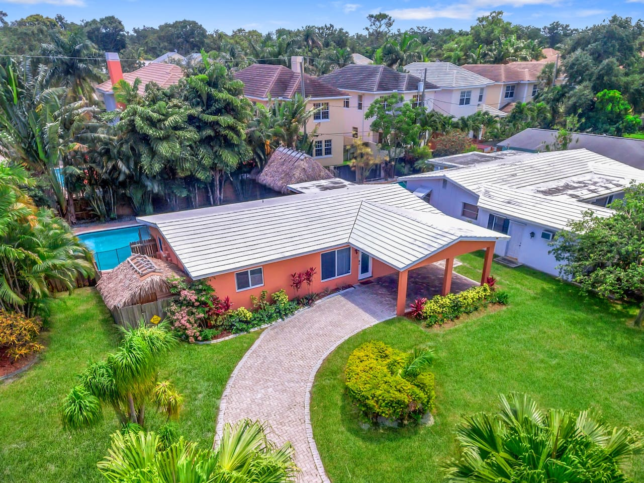Welcome to Fort Lauderdale! This renovated home is professionally managed by TurnKey Vacation Rentals.This 3BR home features a lushly landscaped pool area with tiki hut and outdoor dining area.