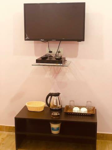 Few amenities . Smart tv with DTH, Tea coffee arrangemebt
