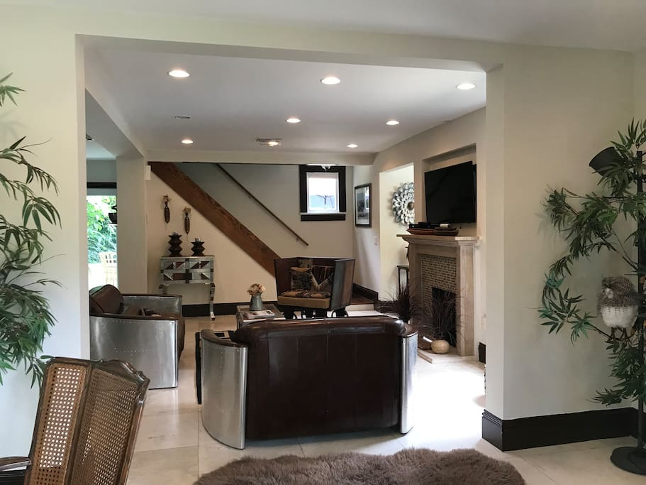 The entire 1st floor is open with plenty of room for your family or group to eat together or just enjoy each other's company. A large screen TV is above the fireplace.