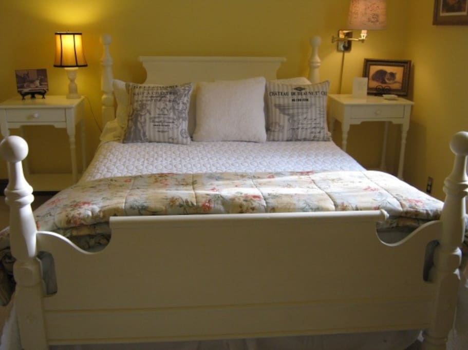Yellow room has queen bed and ensuite