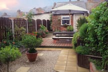 Relax in our private south facing (often sunny) garden, with table, seating & outdoor lighting