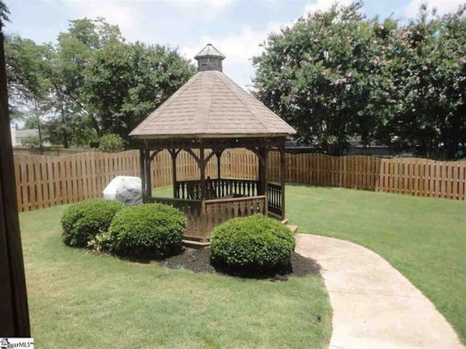 Gazebo right in the fenced backyard with a swing inside to relax, also a charcoal grill available next to the gazebo.