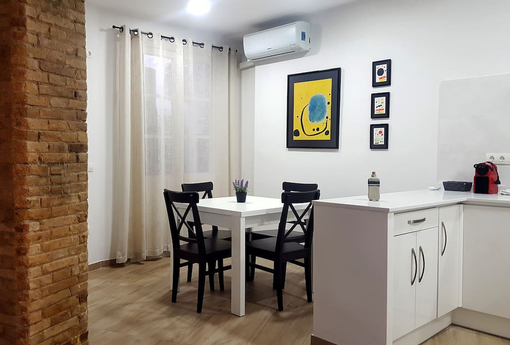 Dinning area with air conditioner, kitchen