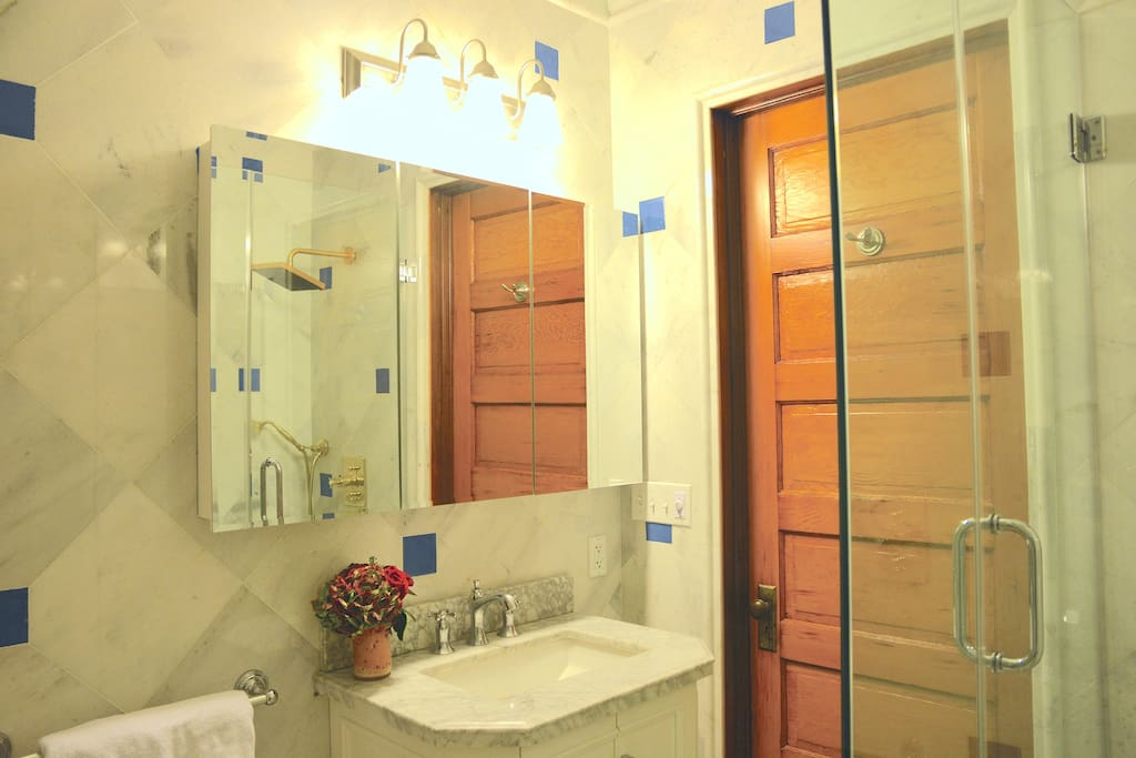 Royal suite bathroom is made of beautiful white marble and blue terra cotta and patterns of marbles on the floor.