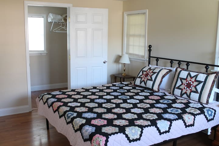 Master bedroom suite -king size bed -door to the left of the bed leads to a large walk-in closet with the laundry area