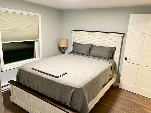 Bedroom one- Queen Bed, nightstand with USB ports and closet