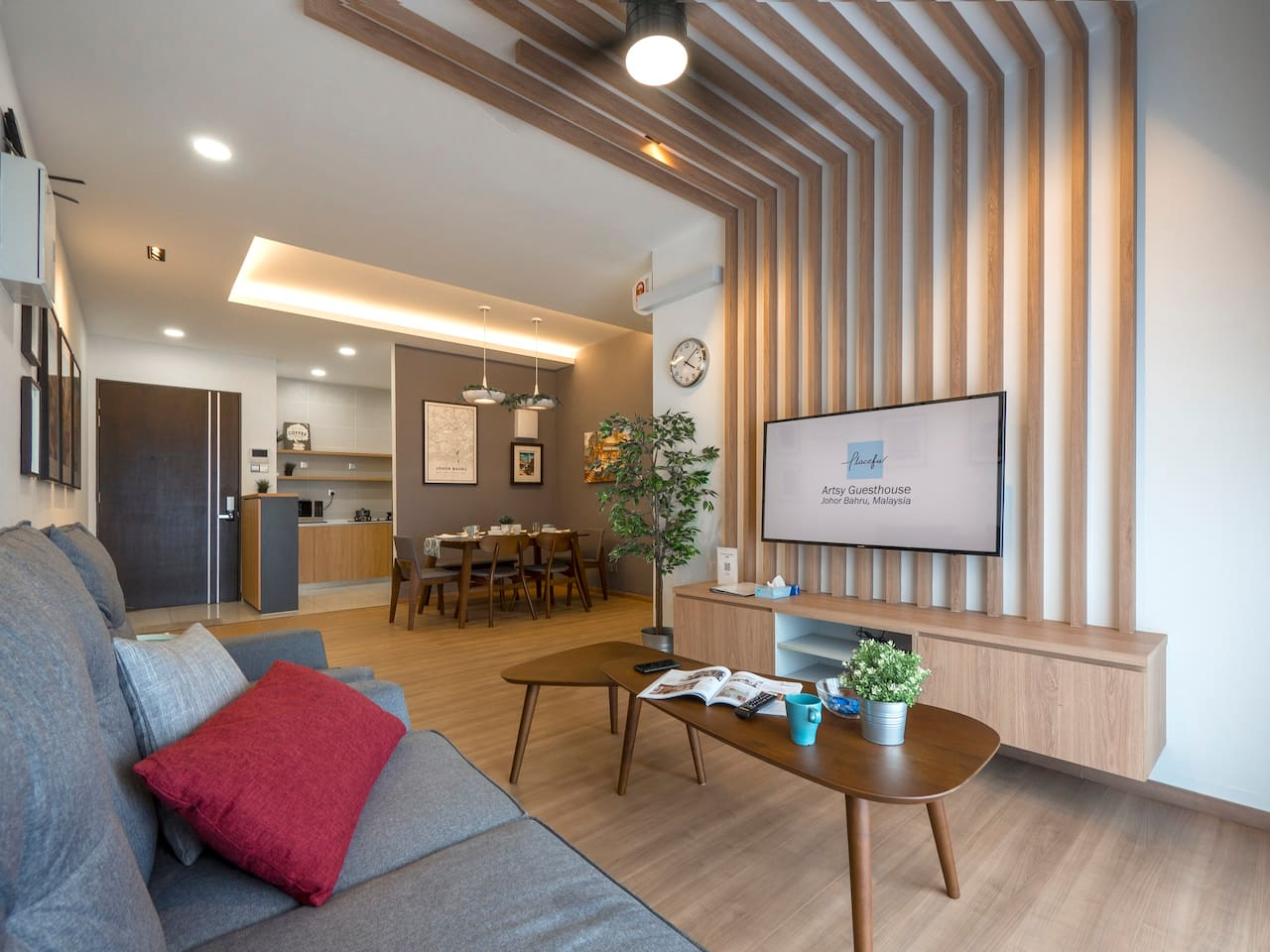 A cosy living area with a private art gallery. You can enjoy your Netflix show in the comfort of the 3+1 seater sofa or simply enjoy the view at the balcony.