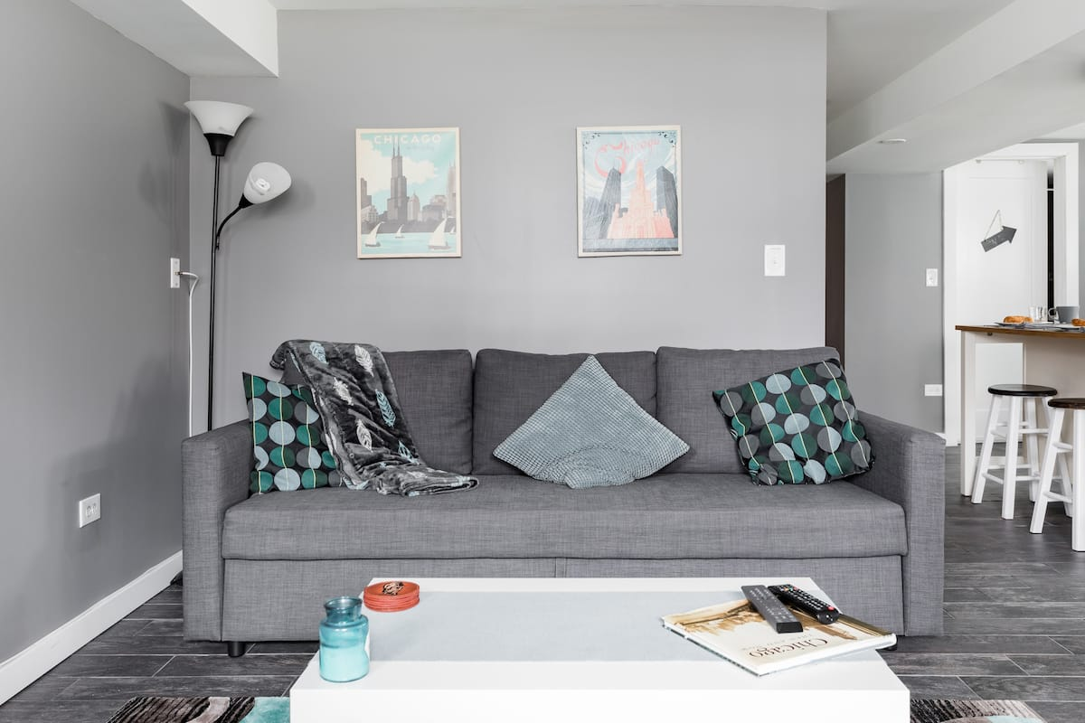 Snuggle up for Movie Night at a Soothing, Gray Urban Getaway