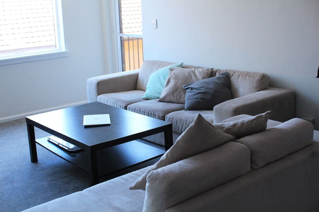Large open plan Lounge room with two couches, internet, flat screen TV and stereo.
