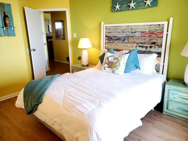 Master bedroom with comfortable queen size bed. Oceaun view from bedroom and cable TV