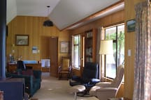 Large sunny living area, with wood burner