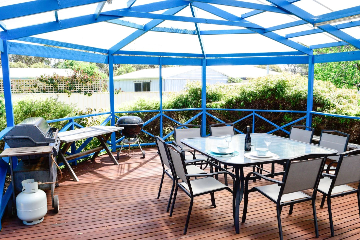 Stunning undercover deck with seating for 8 - hear the ocean and the birds while you dine
