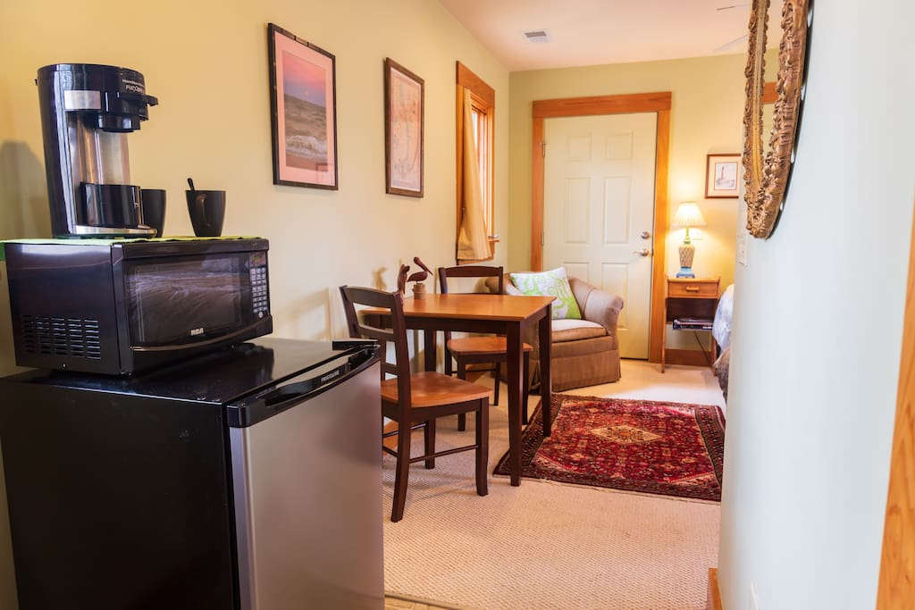 Mini fridge, freezer, microwave, Single cup coffee and tea Flexbrew with Caffeinated Pods and condiments provided!!  Table for two and swivel chair - perfect spot to read a book or do some work on your laptop! Empty dresser located in large closet for your convenience!